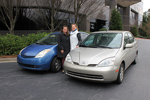 photo of Candice Groves and Eileen Gohr in front of their cars
