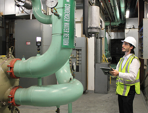 photo of engineer commissioning a building's systems and controls | LEED Commissioning (Cx)