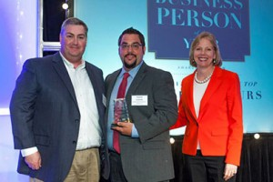 photo of Charlie Cichetti accepting an award | Sustainable Investment Group (SIG)