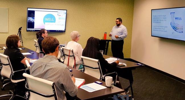 photo of Charlie Cichetti teaching a WELL AP Class