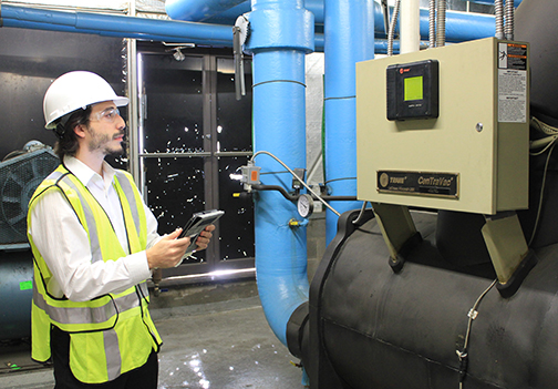 photo of engineer performing commissioning | benefits of commissioning | SIG commissioning | Sustainable Investment Group (SIG) commissioning | Nick Kassanis performing benefits of commissioning | retro-commissioning | benefits of Cx | benefits of RCx |SIG Cx | SIG RCx