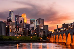 photo of Minneapolis Minnesota Downtown and the Stone Arch Bridge at Sunset | LEED certification | LEED for Cities | LEED City | LEED for City certification