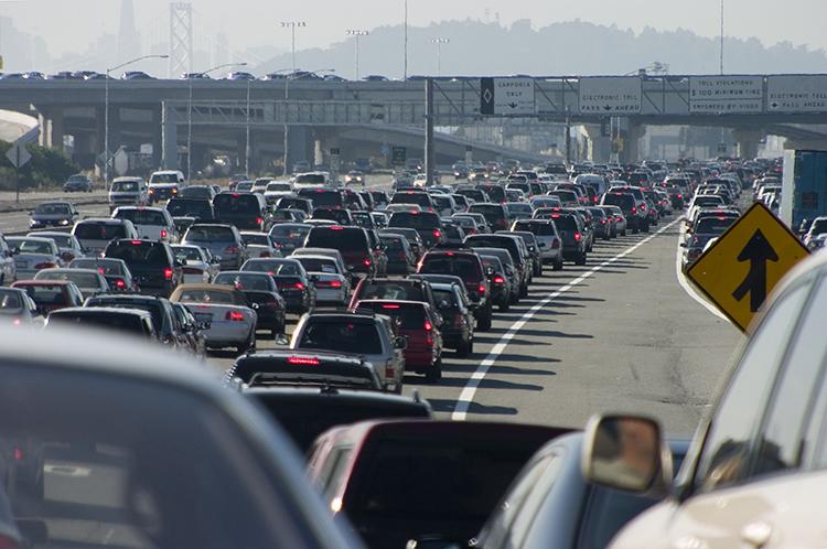 photo of rush-hour traffic approaching the Oakland-San Francisco Bay Bridge