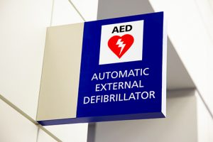 photo of an AED Automated External Defibrillator sign in a commercial building | fitwel