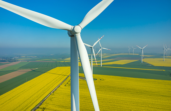 renewable energy | aerial view of the windmills in the field