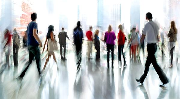 people walking in office lobby
