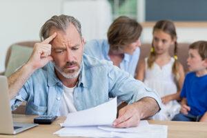 worried dad looking at bills